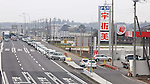 March 17, 2011, Tokyo, Japan - Motor vehicles line up for hours for gasoline at a local filling station in downtown Tokyo along the national route four leading to the quake-hit northeastern area and the troubled nuclear power plant in Fukushima on Tuesday, March 15, 2011. . (Photo by AFLO) [3609] -mis-