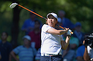 Owings Mills, MD - July 26, 2014: Onnarin Sattayabanphot, of Team Thailand, tees off on the 10th hole during Round 3 of four-ball competition at the LPGA International Crown at the Caves Valley Golf Club in Owings Mills, MD on July 26, 2014. 32 players from twelve countries competed in this inaugural tournament.  (Photo by Don Baxter/Media Images International)