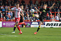 Brad Halliday of Cambridge United clears from Alex Revell of Stevenage during Stevenage vs Cambridge United, Sky Bet EFL League 2 Football at the Lamex Stadium on 14th April 2018
