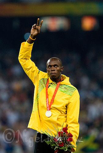 17 AUG 2008 - BEIJING, CHN - Usain Bolt (JAM) celebrates winning the Mens 100m final -  Beijing Olympics. (PHOTO (C) NIGEL FARROW) *** IOC RULES APPLY ON USAGE ***
