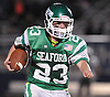 Danny Roell #23 of Seaford rushes for a gain during the Nassau County varsity football Conference IV final against Carle Place-Wheatley at Hofstra University on Saturday, Nov. 19, 2016. He ran 40 times for 190 yards and two touchdowns in Seaford's 20-0 win.