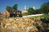 historic Old Salem, NC grounds showing buildings and rock wall in foreground. Old Salem North Carolina USA.