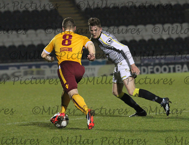 Jack Baird watches Craig Moore in the St Mirren v Motherwell Scottish Professional Football League Development League match played at St Mirren Park, Paisley on 17.3.15.