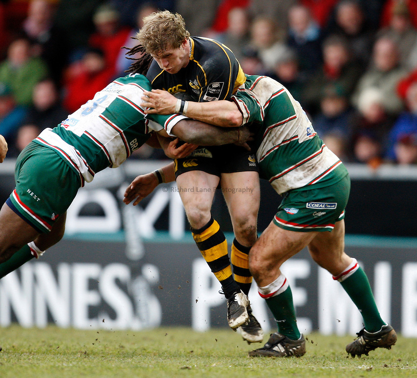 Photo: Richard Lane/Richard Lane Photography..Leicester Tigers v London Wasps. Guinness Premiership. 29/03/2008. Wasps' Tom Rees is tackled by the Tigers' defence.