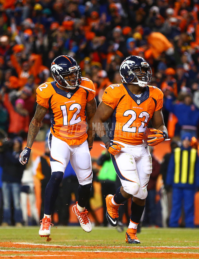 Jan 17, 2016; Denver, CO, USA; Denver Broncos running back C.J. Anderson (22) celebrates his touchdown with wide receiver Andre Caldwell (12) against the Pittsburgh Steelers during the AFC Divisional round playoff game at Sports Authority Field at Mile High. Mandatory Credit: Mark J. Rebilas-USA TODAY Sports