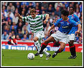 Rangers V Celtic- SPL - Ibrox Stadium, Glasgow -  Celtic's Petrov and Rangers Mols attack the ball ... Pic Donald MacLeod 04.10.03