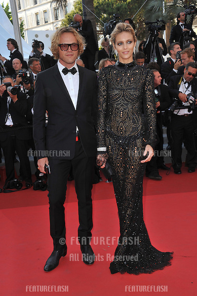 "Anja Rubik & Peter Dundas at the premiere of ""This Must Be The Place"" in competition at the 64th Festival de Cannes..May 20, 2011  Cannes, France.Picture: Paul Smith / Featureflash"