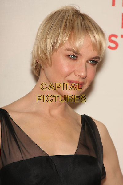 "RENEE ZELLWEGER .attending the 2010 Tribeca Film Festival Premiere of ""My Own Love Song"" held at the Tribeca Performing Arts Center, New York, NY, USA,  22nd April 2010..portrait headshot fringe short hair cut black   tulle sheer see thru through straps  mouth open profile                   .CAP/LNC/TOM.©LNC/Capital Pictures."