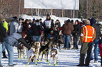 Brent Sass takes a short break amongst the crowd during the ceremonial start of the Iditarod sled dog race Anchorage Saturday, March 2, 2013. ..Photo (C) Jeff Schultz/IditarodPhotos.com  Do not reproduce without permission