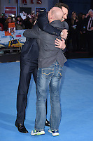 "Hugh Jackman and Eddie the Eagle Edwards<br /> at the ""Eddie the Eagle"" European premiere, Odeon Leicester Square London<br /> <br /> <br /> ©Ash Knotek  D3099 17/03/2016"