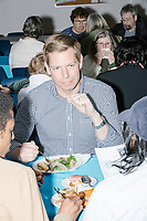 Democratic presidential candidate and Congressional Representative Eric Swalwell (D-CA 15th) talks with people while eating at the Milford Democrats' Potluck Supper at the Unitarian Universalist Congregation Church in Milford, New Hampshire, USA, on Sat., Apr. 6, 2019. Swalwell is running primarily on gun control issues.