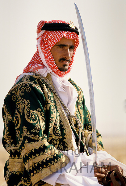 Bedouin on horseback in the desert in Saudi Arabia
