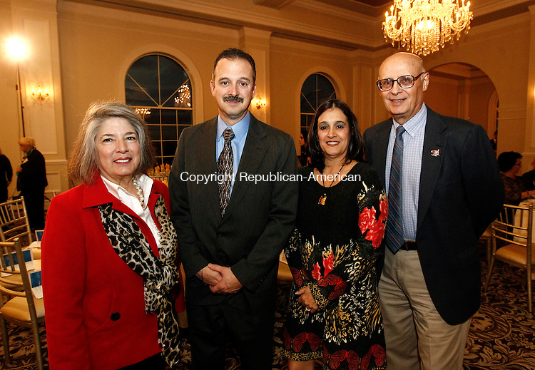 Prospect, CT- 30 October 2014-103014CM15-  SOCIAL MOMENTS--- Left to right Gloria Mancini from Wolcott, Jim Perreault from Wolcott, Donna LoCurto from Prospect, and Dominic Rinaldi from Waterbury,  photographed during the Waterbury Neighborhood Council Awards Dinner at Aria Banquet Hall in Prospect on Thursday. Christopher Massa Republican-American