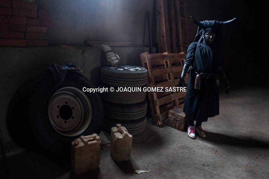 A young man with his devil costume is preparing to participate in the carnival of Luzon (Guadalajara)