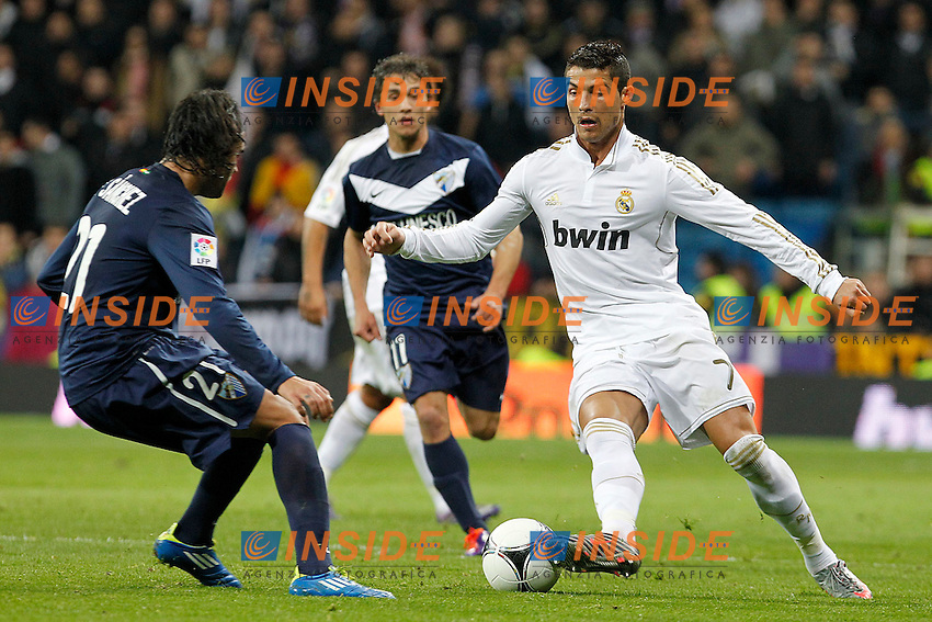 Real Madrid's Cristiano Ronaldo (r) and Malaga's Sergio Sanchez during Spanish King's Cup match.January 3,2011. (Insidefoto/ALTERPHOTOS/Acero) .Madrid 3/1/2012 Stadio Santiago Bernabeu.Cppa del Re.Real Madrid Malaga