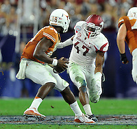 NWA Media/Michael Woods --12/29/2014-- w @NWAMICHAELW...University of Arkansas linebacker Martrell Spaight puts the pressure on Texas quarterback Tyrone Swoops in the 1st quarter of the Texas Bowl Monday night at  NRG Stadium in Houston.