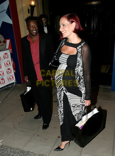 CARRIE & DAVID GRANT.TV Quick & TV Choice Awards at the Dorchester Hotel, Park Lane, London..September 5th, 2005.full length goody bags pregnant bum black white dress.www.capitalpictures.com.sales@capitalpictures.com.© Capital Pictures.