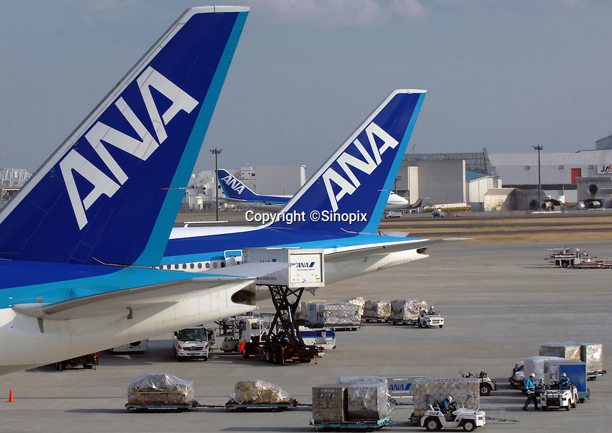 All Nippon Airways (ANA) planes wait on the tarmac of Narita International Airport, Tokyo, Japan.
