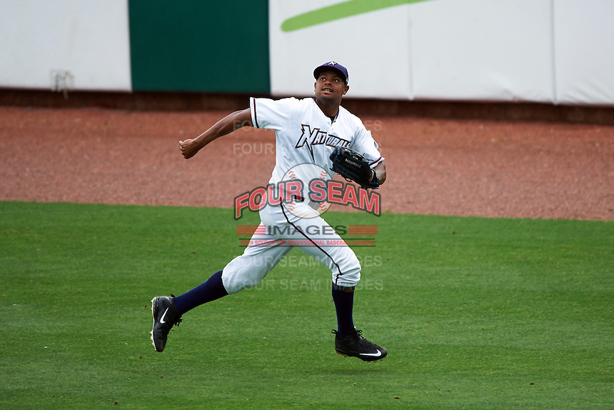 NW Arkansas Naturals outfielder Jorge Bonifacio (24) tracks a fly ball during a game against the San Antonio Missions on May 31, 2015 at Arvest Ballpark in Springdale, Arkansas.  NW Arkansas defeated San Antonio 3-1.  (Mike Janes/Four Seam Images)