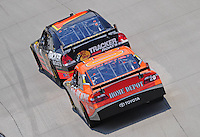 Jun 1, 2008; Dover, DE, USA; NASCAR Sprint Cup Series driver Martin Truex Jr (1) leads Tony Stewart (20) during the Best Buy 400 at the Dover International Speedway. Mandatory Credit: Mark J. Rebilas-US PRESSWIRE