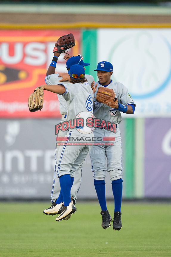 Bluefield Blue Jays outfielders Nick Sinay (6), Edward Olivares (2), and Earl Burl III (3) celebrate their win over the Burlington Royals at Burlington Athletic Stadium on June 26, 2016 in Burlington, North Carolina.  The Blue Jays defeated the Royals 4-3.  (Brian Westerholt/Four Seam Images)