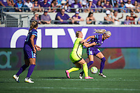 Orlando, Florida - Sunday, May 8, 2016: Seattle Reign FC forward Merritt Mathias (9) and Orlando Pride midfielder Kaylyn Kyle (6) fight for possession during a National Women's Soccer League match between Orlando Pride and Seattle Reign FC at Camping World Stadium.