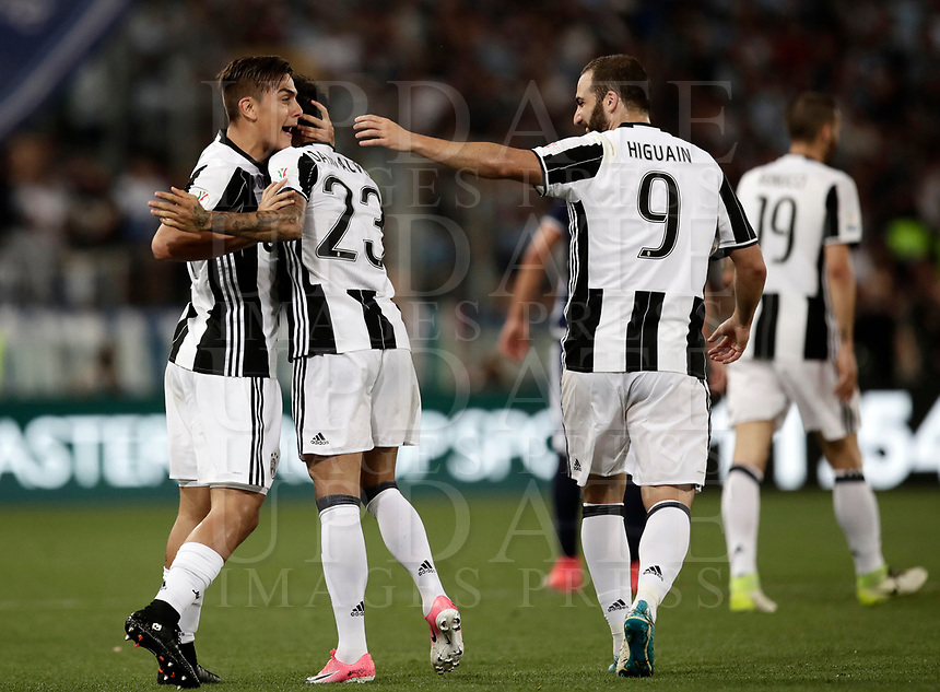 Calcio, Tim Cup: finale Juventus vs Lazio. Roma, stadio Olimpico, 17 maggio 2017.<br /> Juventus' Dani Alves, left, celebrates with his teammates Paulo Dybala, left, and Gonzalo Higuain after scoring during the Italian Cup football final match between Juventus and Lazio at Rome's Olympic stadium, 17 May 2017.<br /> UPDATE IMAGES PRESS/Isabella Bonotto