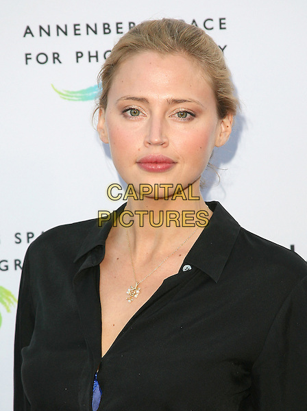 ESTELLA WARREN .at The opening of BEAUTY CULTURE, a photographic exploration of how feminine beauty is defined, challenged and revered in modern society held at Annenberg Space for Photography in Century City, California, USA,.May 19th 2011..portrait headshot gold necklace black shirt                                               .CAP/RKE/DVS.©DVS/RockinExposures/Capital Pictures.