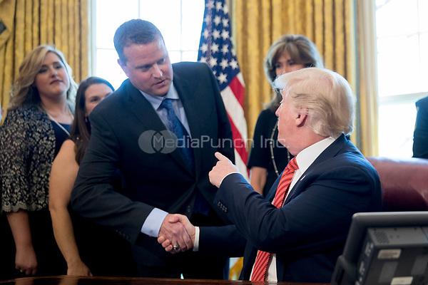 United States Darren Ellisor, a Southwest Airlines Co. first officer, while meeting with the crew and passengers of Southwest Airlines flight 1380 in the Oval Office of the White House in Washington, D.C., U.S., on Tuesday, May 1, 2018. An engine on Southwest's flight 1380, a Boeing Co. 737-700 bound for Dallas from New York's LaGuardia airport, exploded and made an emergency landing on April 17 sending shrapnel into the plane and killing a passenger seated near a window.<br /> Credit: Andrew Harrer / Pool via CNP /MediaPunch