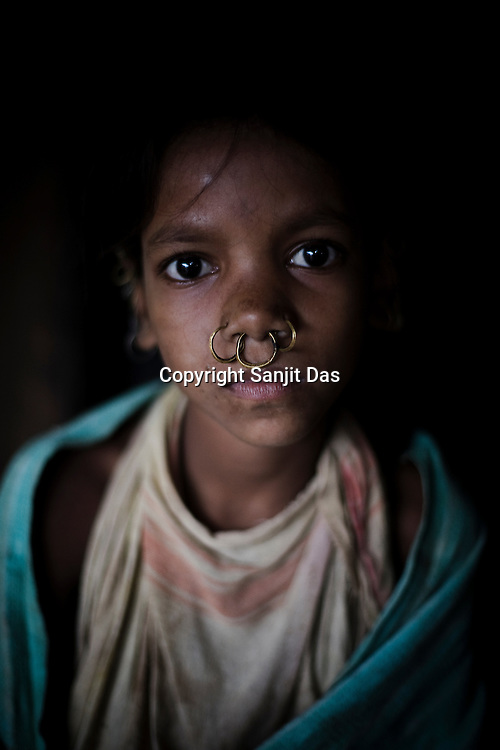 Tomy Sikaka poses for a portrait in Salpojola village in Niyamgiri hills. She is one of the many people who will get displaced if the aluminium company Vedanta carries on with its plans of mining of Bauxide in Niyamgiri hills in Rayagara district of Orissa in India.