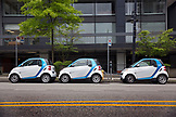 CANADA, Vancouver, British Columbia, car2go cars are parked on a street in downtown Vancouver, part of a car sharing program