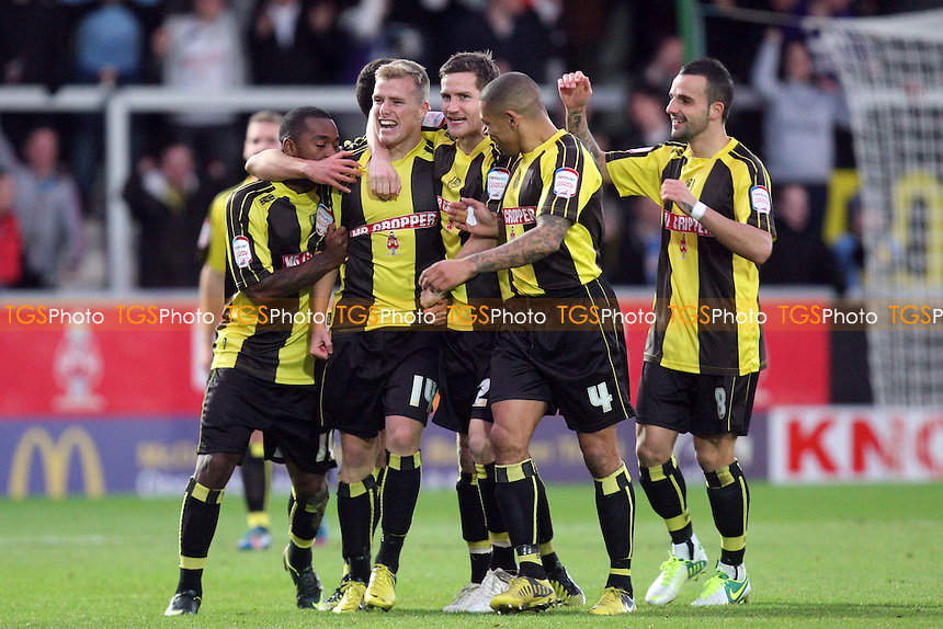 Damien McCrory of Burton Albion is congratulated for scoring the opening Burton goal - Burton Albion vs Dagenham and Redbridge at the Pirelli Stadium  - 17/11/12 - MANDATORY CREDIT: Dave Simpson/TGSPHOTO - Self billing applies where appropriate - 0845 094 6026 - contact@tgsphoto.co.uk - NO UNPAID USE.