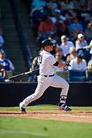 New York Yankees first baseman Ryan McBroom (73) follows through on a swing during a Grapefruit League Spring Training game against the Toronto Blue Jays on February 25, 2019 at George M. Steinbrenner Field in Tampa, Florida.  Yankees defeated the Blue Jays 3-0.  (Mike Janes/Four Seam Images)