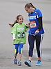 Lexi Jampole, 7, and mother Krista Jampole of Bayside walk from the parking lot of Mitchel Athletic Complex as they prepare for their respective 1 mile and 5K runs preceding Sunday's Long Island Marathon on Saturday, Apr. 30, 2016.