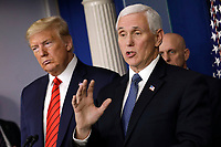 United States Vice President Mike Pence, right, speaks next to US President Donald J. Trump, left, during a press briefing on the Coronavirus COVID-19 pandemic with members of the Coronavirus Task Force at the White House in Washington on March 19, 2020. <br /> Credit: Yuri Gripas / Pool via CNP/AdMedia