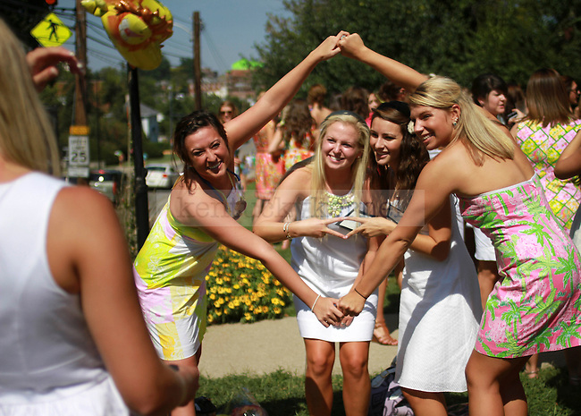 Pledges and sisters of the Alpha Delta Pi sorority pledges pose for a picture at their sorority house to celebrate bid day on August 20, 2010.