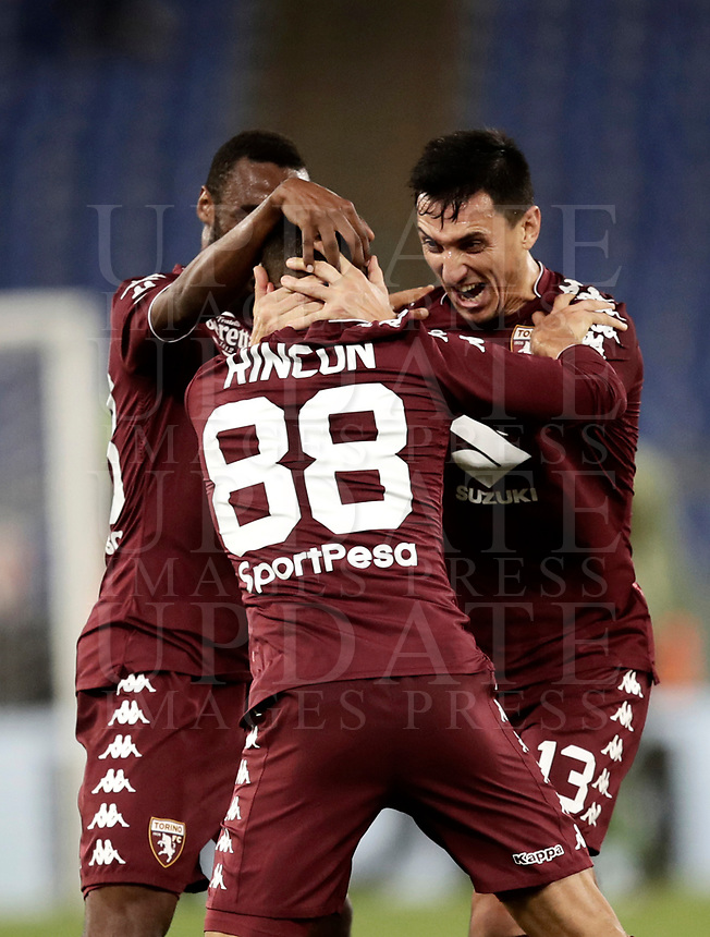 Calcio, Serie A: Roma, stadio Olimpico, 11 dicembre 2017.<br /> Torino's Tomas Rincon (c) celebrates after scoring with his teammates Nicolas Burdisso (r) and Nicolas Nkoulou (l) during the Italian Serie A football match between Lazio and Torino at Rome's Olympic stadium, December 11, 2017.<br /> UPDATE IMAGES PRESS/Isabella Bonotto