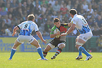 Danny Care of Harlequins looks for a way through Michael Claassens (left) and Carl Fearns of Bath Rugby during the Aviva Premiership match between Harlequins and Bath Rugby at The Twickenham Stoop on Saturday 24th March 2012 (Photo by Rob Munro)