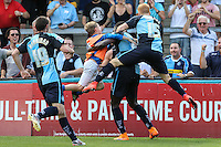 Aaron Pierre of Wycombe Wanderers (2nd right) celebrates scoring his team's first goal to make it 1-1 during the Sky Bet League 2 match between Wycombe Wanderers and Dagenham and Redbridge at Adams Park, High Wycombe, England on 22 August 2015. Photo by David Horn.