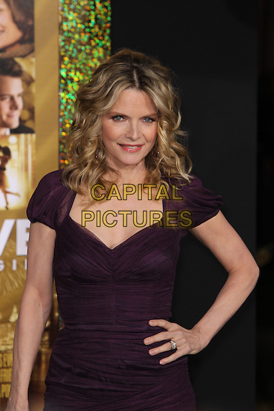 "Michelle Pfeiffer.The World Premiere of ""New Year's Eve' held at The Grauman's Chinese Theatre in Hollywood, California, USA..December 5th, 2011.half length dress hand on hip purple .CAP/CEL .©CelPh/Capital Pictures."