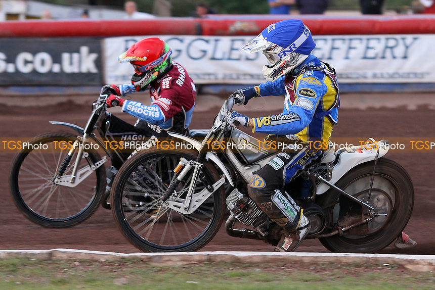 Heat 1: Lee Richardson (red) and Cameron Woodward (blue) - Lakeside Hammers vs Swindon Robins - Elite League Speedway at Arena Essex Raceway - 12/08/11 - MANDATORY CREDIT: Gavin Ellis/TGSPHOTO - Self billing applies where appropriate - 0845 094 6026 - contact@tgsphoto.co.uk - NO UNPAID USE.