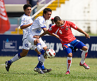 John Ruiz (9) of Costa Rica holds off Victorino Zelaya (3) of El Salvador during the group stage of the CONCACAF Men's Under 17 Championship at Jarrett Park in Montego Bay, Jamaica. Costa Rica defeated El Salvador, 3-2.