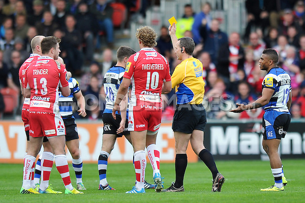 Referee Tim Wigglesworth issues Dave Attwood a yellow card for cynical play. Aviva Premiership match, between Gloucester Rugby and Bath Rugby on April 12, 2014 at Kingsholm Stadium in Gloucester, England. Photo by: Patrick Khachfe / Onside Images