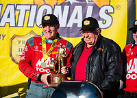 Feb 11, 2019; Pomona, CA, USA; NHRA top fuel driver Doug Kalitta (left) celebrates with team owner Connie Kalitta after winning the Winternationals at Auto Club Raceway at Pomona. Mandatory Credit: Mark J. Rebilas-USA TODAY Sports