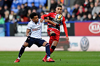 Derik Osede of Bolton Wanderers battles for the ball with Abdelhamid Sabiri of Huddersfield Town during Bolton Wanderers vs Huddersfield Town, Emirates FA Cup Football at the Macron Stadium on 6th January 2018