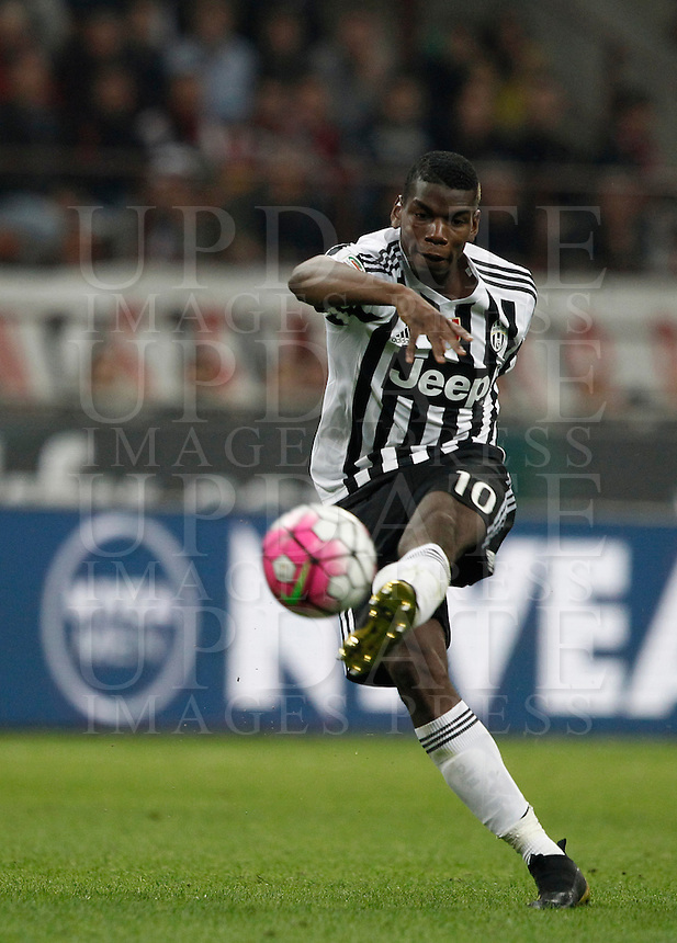 Calcio, Serie A: Milan vs Juventus. Milano, stadio San Siro, 9 aprile 2016. <br /> Juventus&rsquo; Paul Pogba kicks the ball during the Italian Serie A football match between AC Milan and Juventus at Milan's San Siro stadium, 9 April 2016.<br /> UPDATE IMAGES PRESS/Isabella Bonotto