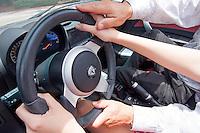 Roman Gomez with his friend, Anastasia Tazmina, in his mother's electric Tesla Roadster at Bayfront, Naples, Florida, USA, July 19, 2012. Photo by Debi Pittman Wilkey, CoastalLife.com.
