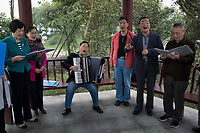 Meishan, Sichuan province, China, October 2014 - Members of a local troupe sing a poem by famous Song dynasty poet and politician Su Dongpo who was native of Meishan.