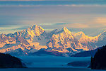 The Fairweather Mountains at sunrise as seen from the water from a small ship, Alaska's Inside Passage, bordering Canada