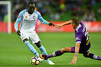Melbourne, 23 April 2017 - RUON TONGYIK (21) of Melbourne City and LUCIAN GOIAN (26) of the Glory fight for the ball in the Elimination Final 2 of the A-League between Melbourne City and Perth Glory at AAMI Park, Melbourne, Australia. Perth won 2-0. Photo Sydney Low/sydlow.com